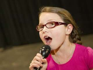 Emily De Martin, 8, rehearses for the upcoming