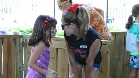 Sophia Chirco, 8, talks to counselor Jamie Sangesland