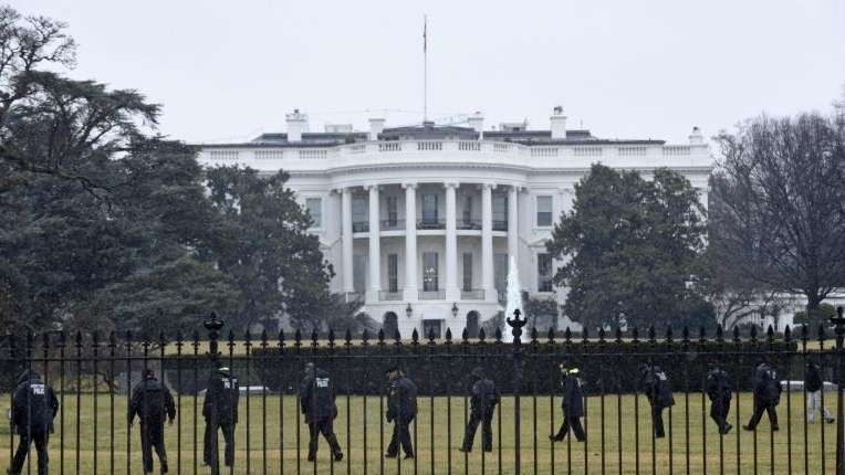 Secret Service officers search the south grounds of