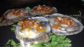 Smoked oysters are served at Viaggio Tapas in