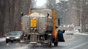 A Department of Public Works vehicle sprays salt