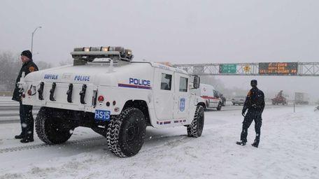 Suffolk County police highway patrol officers keep watch