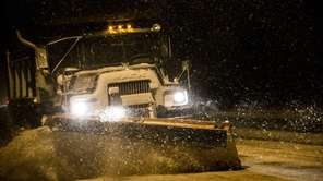 A plow works its way on Route 48