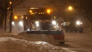 Plows clear Stewart Avenue in Garden City at