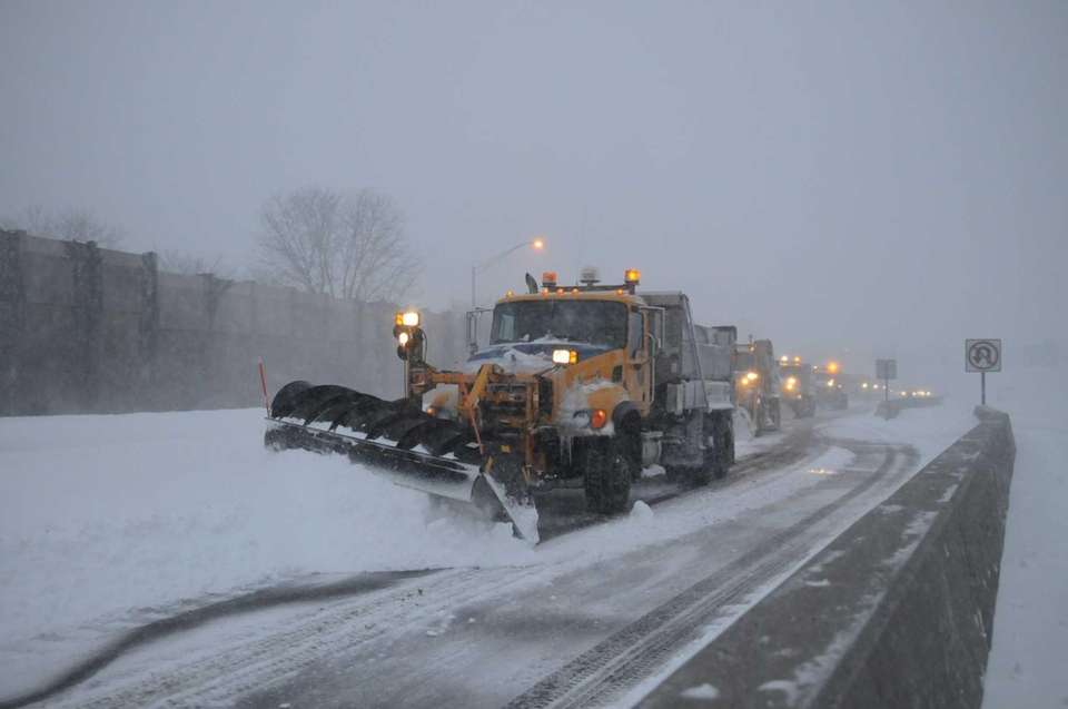 Snow plows clear snow away on the eastbound