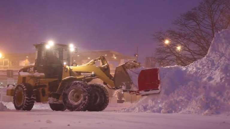 Babylon residents cleared away the snow on Jan.