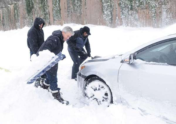 Suffolk County Executive Steve Bellone helps a stranded