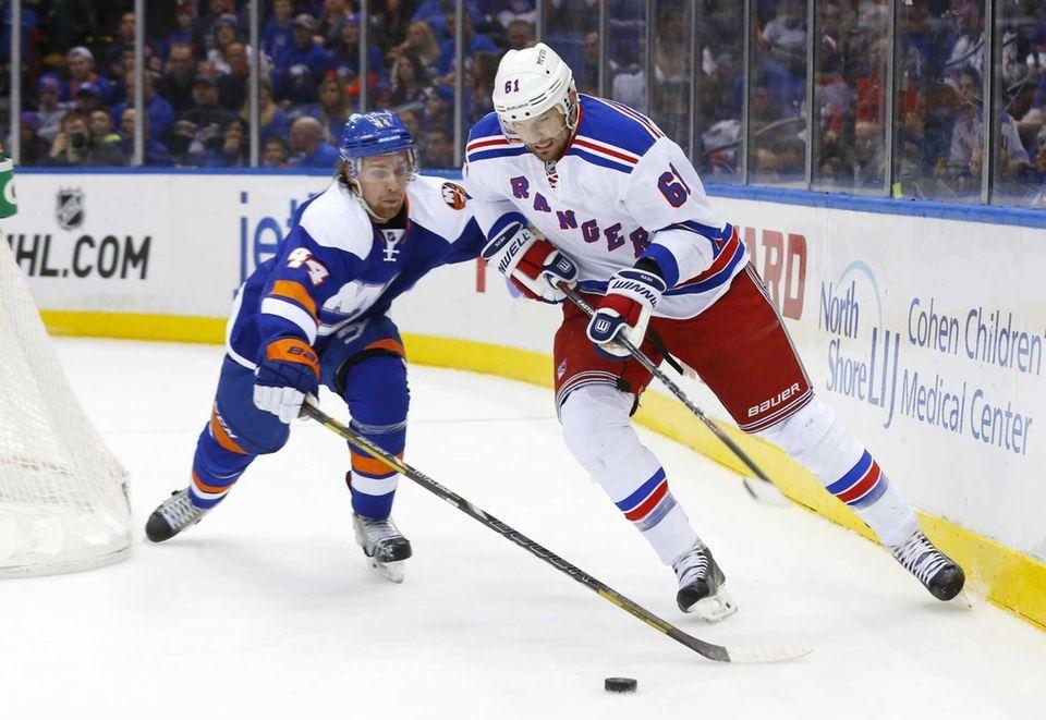 Rick Nash of the New York Rangers tries