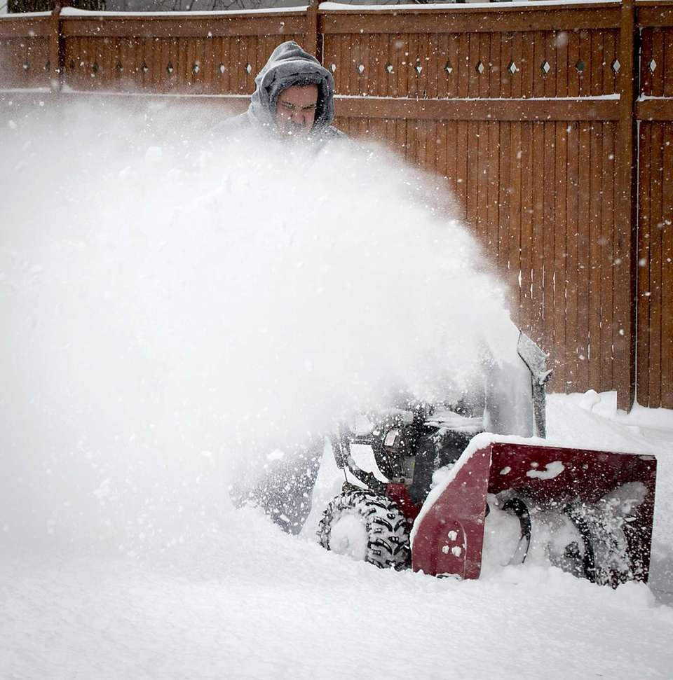 Merrick resident Vinny Grippa digs out of the