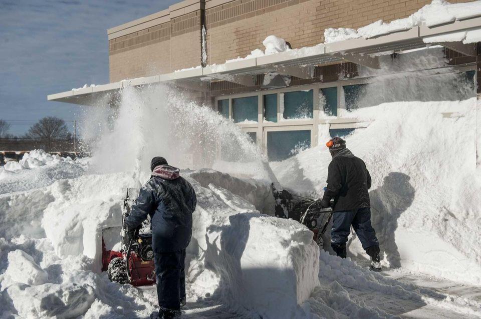 East Hampton School District employees uses snowblowers to