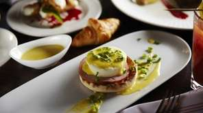 The Three Village Inn's buffet offers Eggs Benedict,