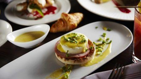 The Three Village Inn's buffet offers Eggs Benedict,