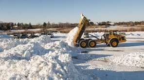 Trucks dump snow from Southampton Village streets at