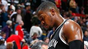 Joe Johnson of the Brooklyn Nets walks off