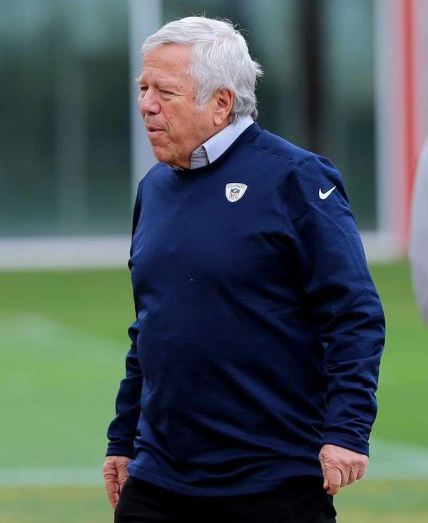 New England Patriots owner Robert Kraft looks on