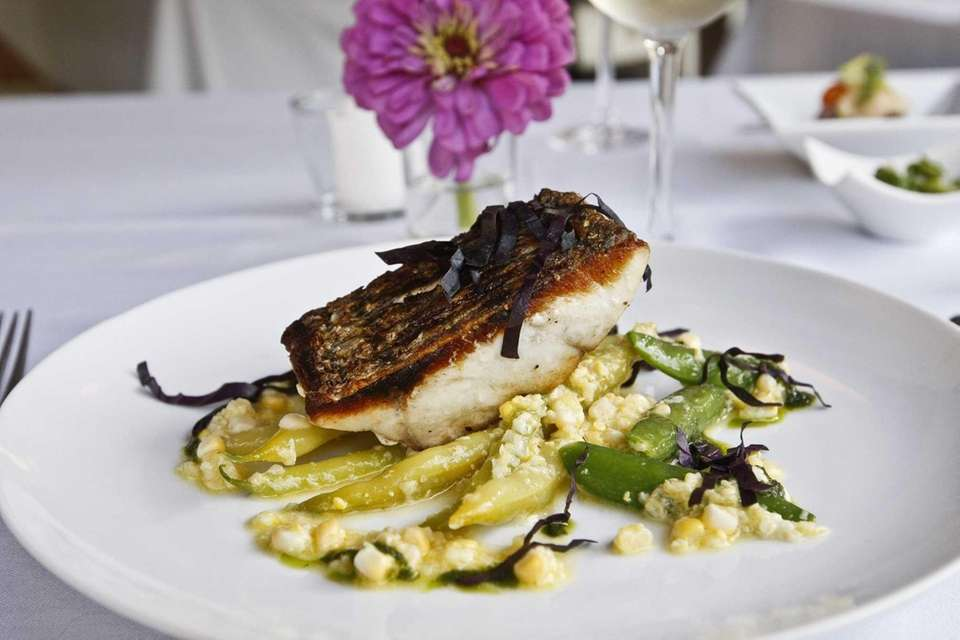 Sauteed Montauk striped bass is served with wax