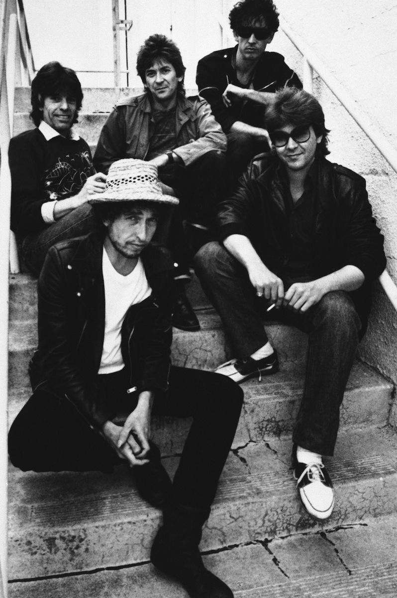Rock singer/musician Bob Dylan, foreground left, poses with