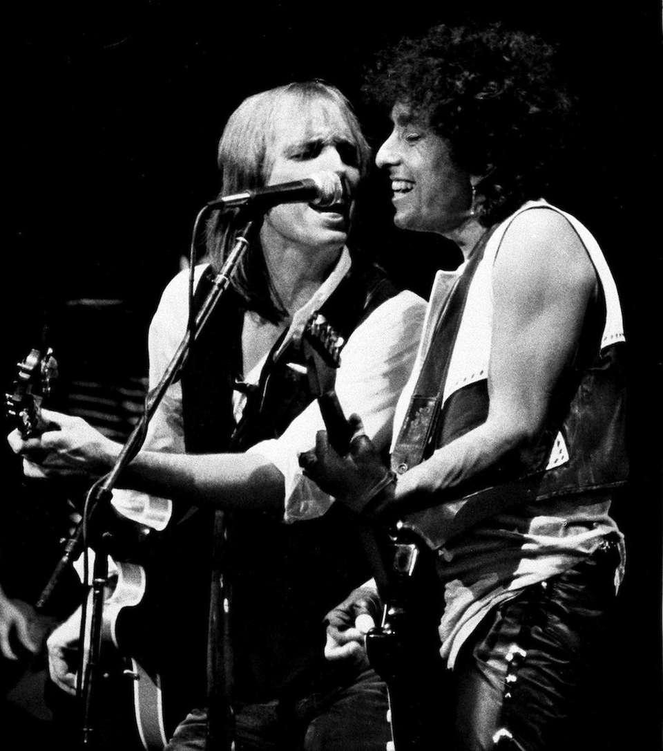 Singers-songwriters Bob Dylan, right, and Tom Petty perform