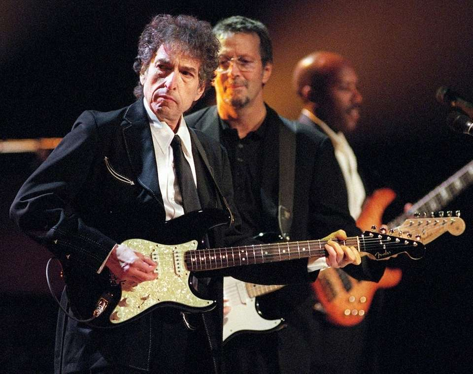 Singer-songwriters Bob Dylan, left, and Eric Clapton perform