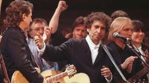 Bob Dylan is joined by other artists after