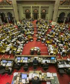 Assembly members discuss and vote on the state