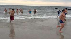 Participants leave the water after jumping in during