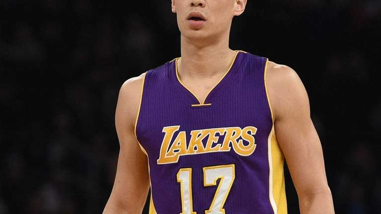 Los Angeles Lakers guard Jeremy Lin looks on