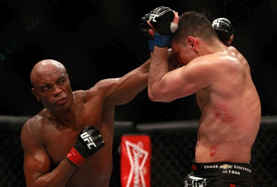 Anderson Silva, left, punches Nick Diaz in their