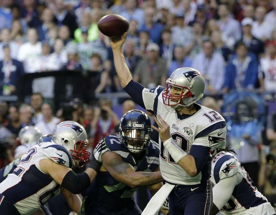 New England Patriots quarterback Tom Brady throws a