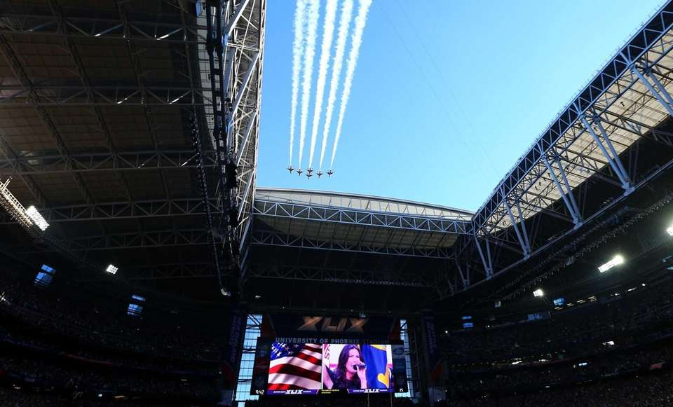 U.S. Air Force Thunderbirds fly over the stadium