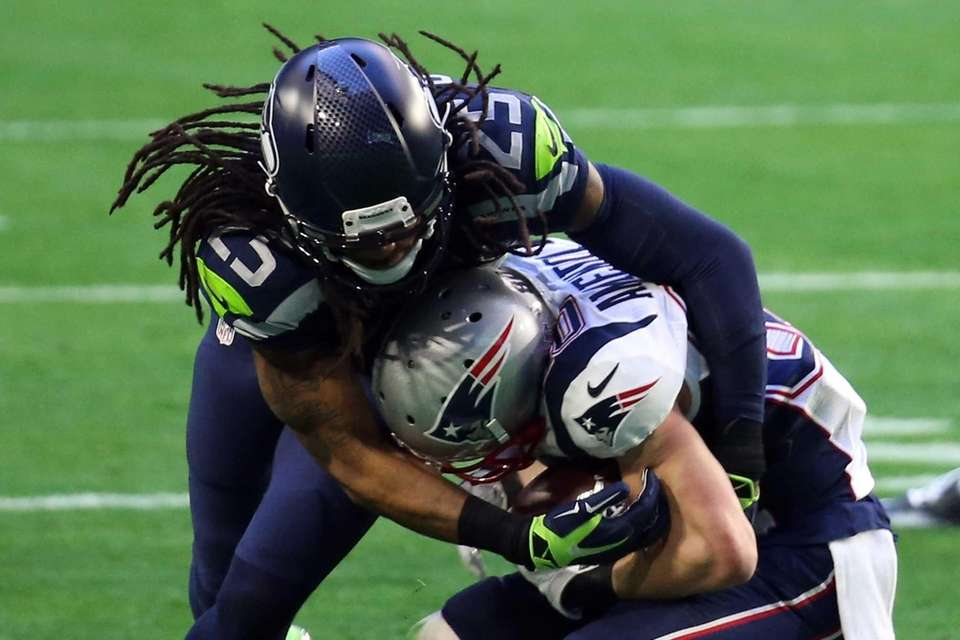 Richard Sherman of the Seattle Seahawks attempts to