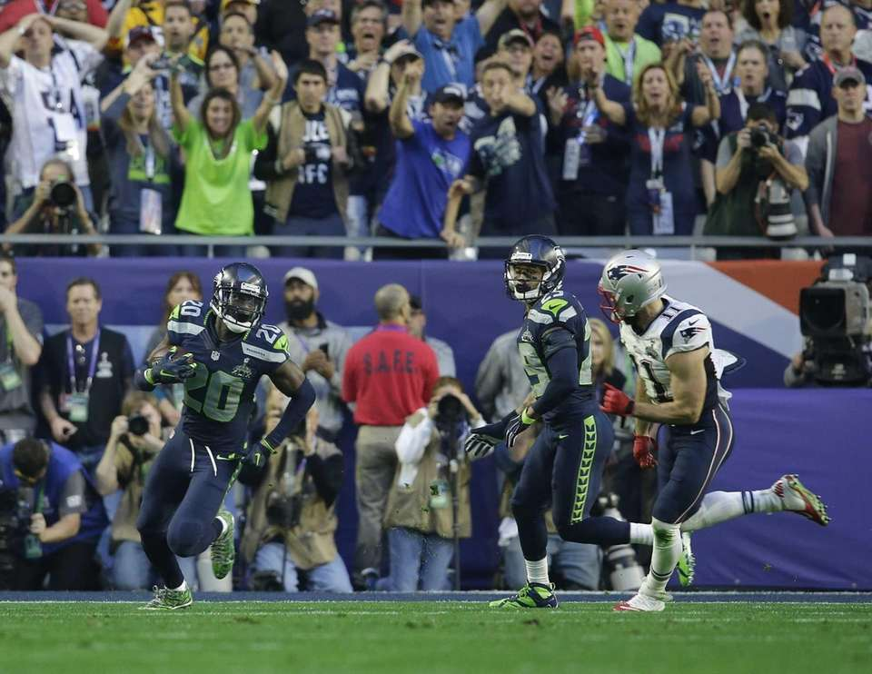 Seattle Seahawks cornerback Jeremy Lane runs after intercepting