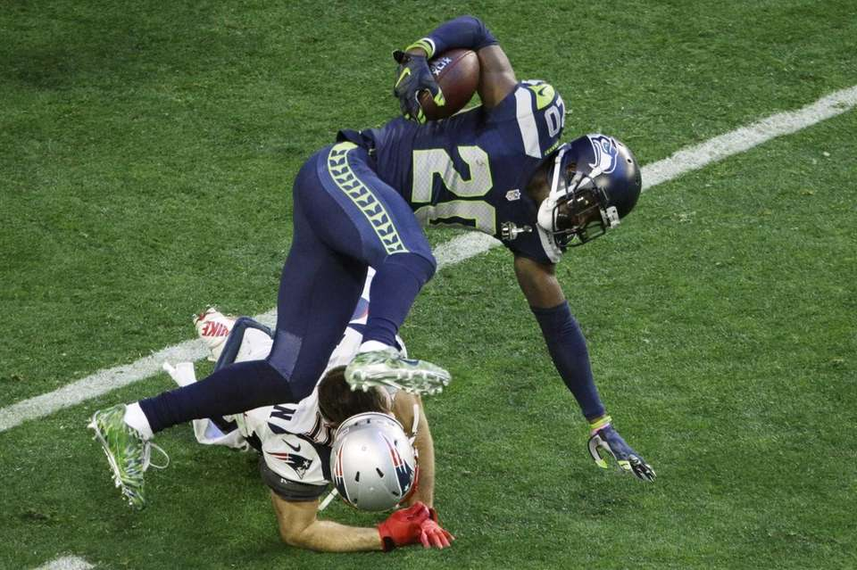 Seattle Seahawks cornerback Jeremy Lane is upended by