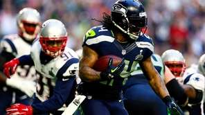 Marshawn Lynch of the Seattle Seahawks runs with