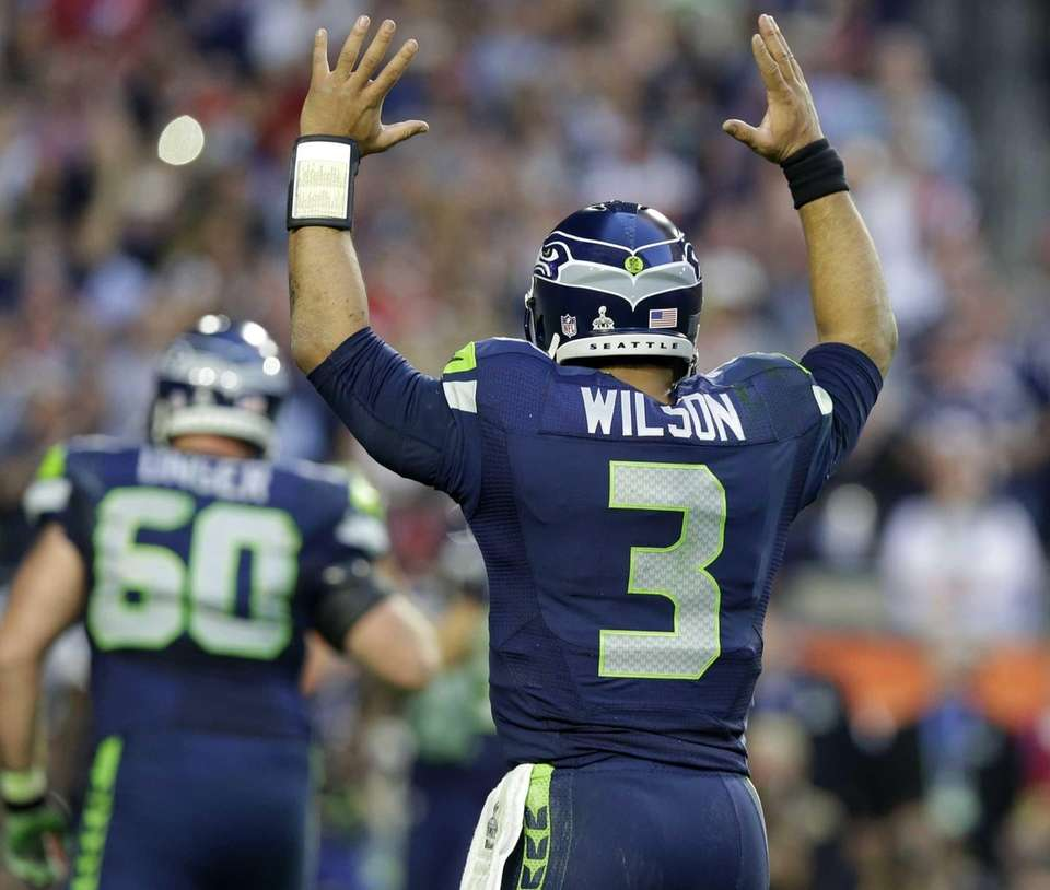 Seattle Seahawks quarterback Russell Wilson celebrates as Marshawn