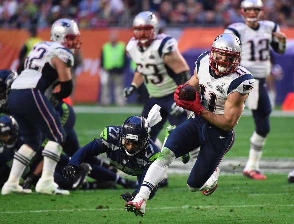 Julian Edelman of the New England Patriots carries