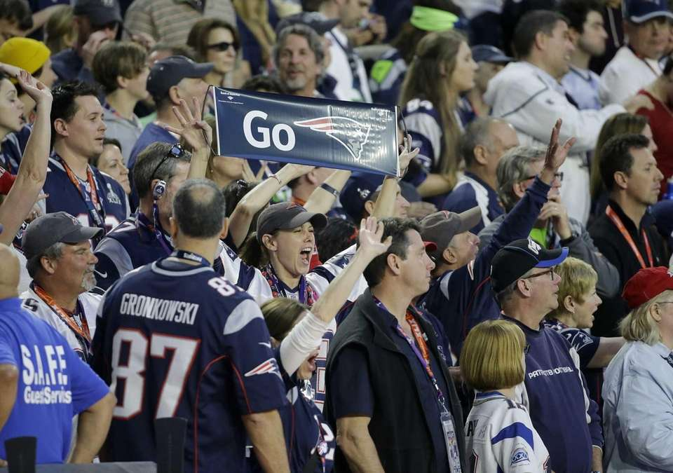 A New England Patriots fan cheers during the