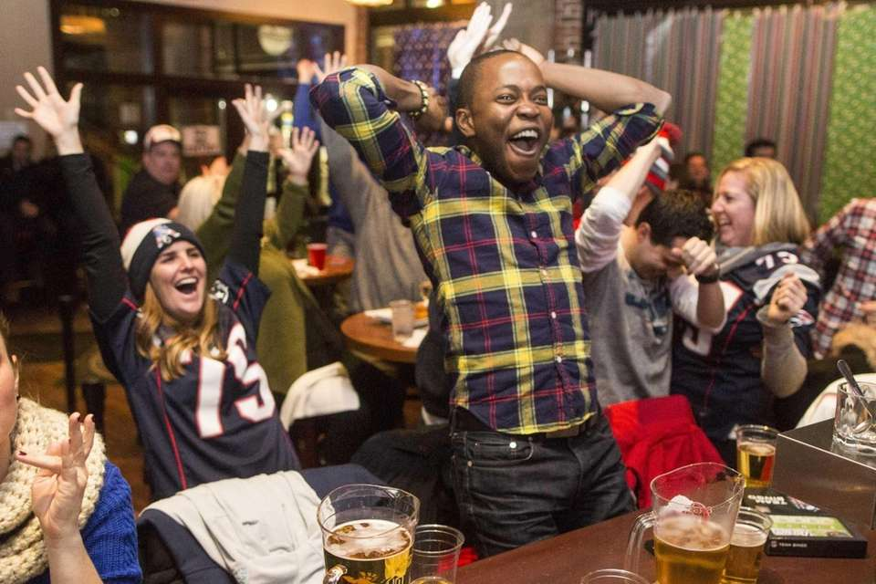 New England Patriots fans react to a touchdown