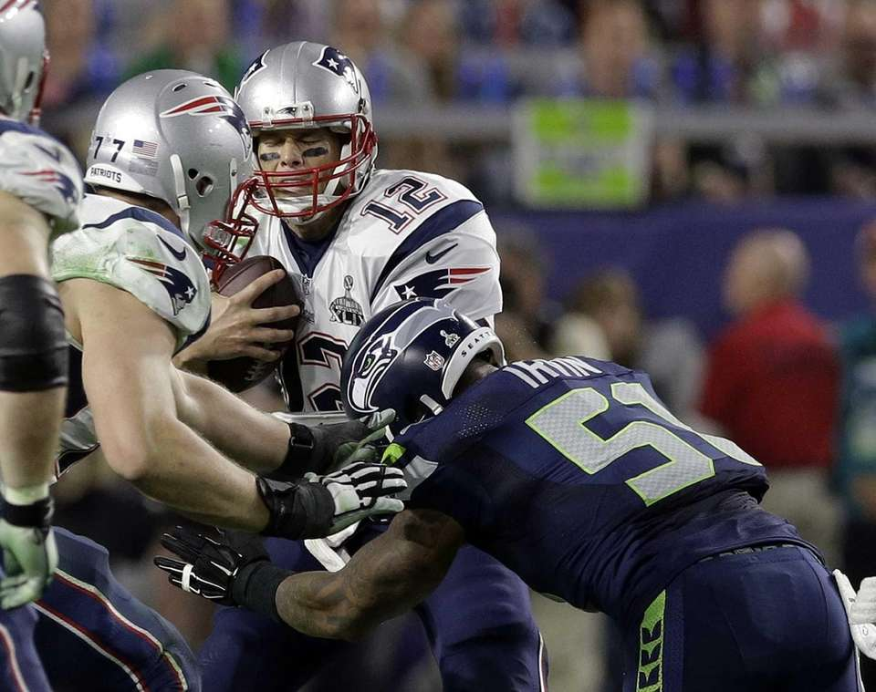 New England Patriots quarterback Tom Brady is sacked