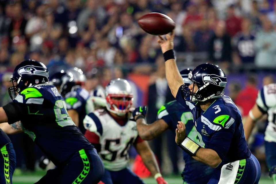 Russell Wilson of the Seattle Seahawks throws a
