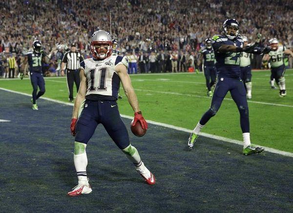 New England Patriots wide receiver Julian Edelman reacts