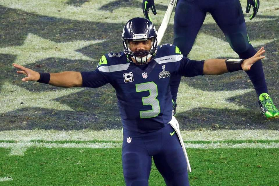 Russell Wilson of the Seattle Seahawks gestures in
