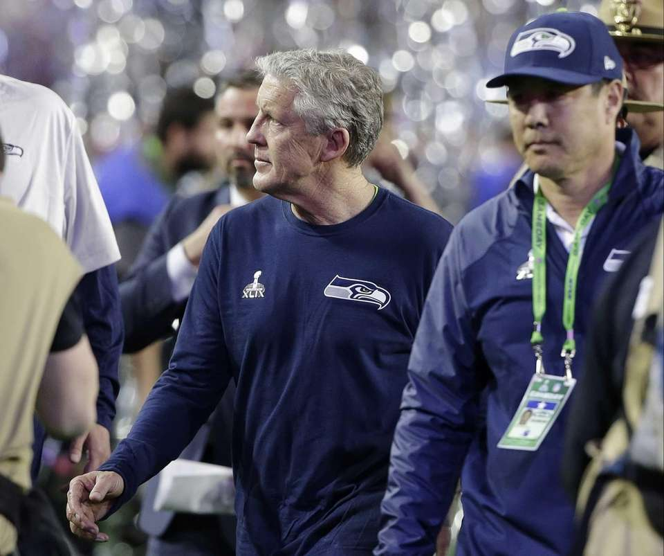 Seattle Seahawks head coach Pete Carroll walks off