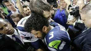 New England Patriots quarterback Tom Brady hugs Seattle