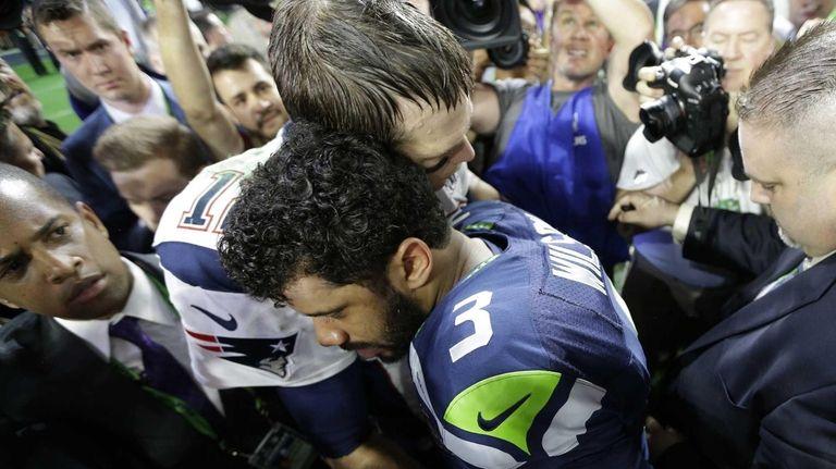 New England Patriots quarterback Tom Brady hugs Seattle