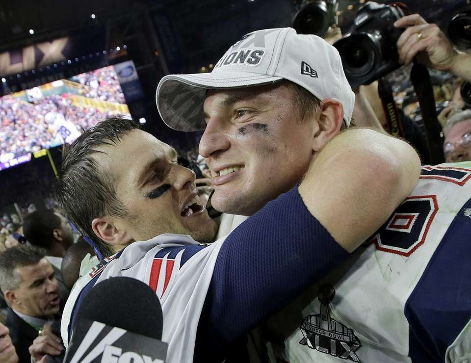 New England Patriots quarterback Tom Brady, left, and
