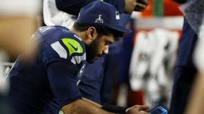 Russell Wilson of the Seattle Seahawks waits on