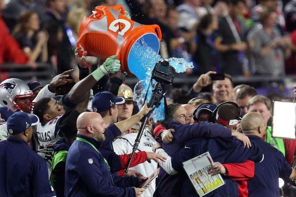 The New England Patriots celebrate late in the