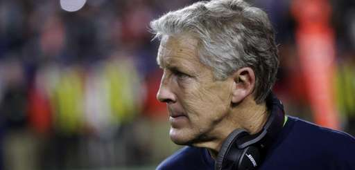 Seattle Seahawks head coach Pete Carroll watches from