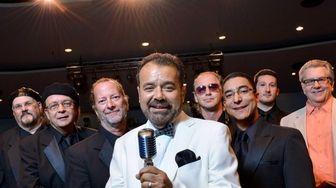 Tito Batista, center, lead singer of the Black